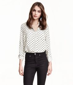 Straight-cut shirt in woven fabric with a narrow turn-down collar, chest pockets, and long sleeves with roll-up tab and button.
