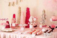 very pink baby shower different shades... the nutcracker (perfect time of year) and look at the little cupcake like things in the bottom right! Love. On the left those are like those twinkie cake things rights? Those trees boah & Styrofoam