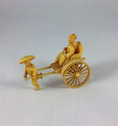 A personal favorite from my Etsy shop https://www.etsy.com/listing/451120072/japanese-celluloid-rickshaw-with-geisha