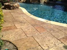 colour might work with existing pavers stamped concrete around