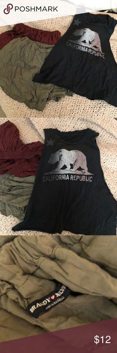 Brandy Melville skirts/tank 2 skirts super cute (sorry so wrinkly) and a muscle tank from brandy Melville! Super cute Brandy Melville Other