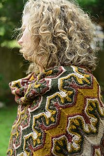 Stunning use of a knitting technique produces a modern folkwear wrap. Xandy Peters' Fox Paws pattern on Ravelry.