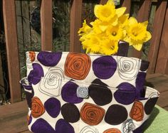 My two sisters and I make our products using up cycled and re purposed designer fabrics. Our bags are made extremely well made, stylish, one of a kind and the work-woman-ship is guaranteed on every product we make https://www.etsy.com/shop/3greensisters