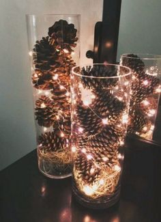 Simple and inexpensive December centerpieces. Made these for my December wedding! Pinecones, spanish moss, fairy lights and dollar store vases. (Hobbies To Try Dollar Stores) Indoor Christmas Decorations, Wedding Decorations, Wedding Centerpieces, Indoor Christmas Lights, Craft Decorations, Wedding Table, Home Decoration, Christmas Decorating Ideas, Halloween Decorations