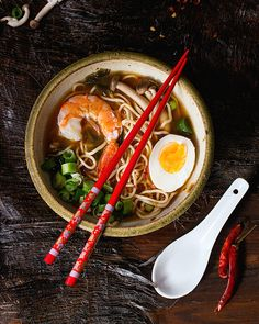 Asian soup ramen with shrimp by NatashaBreen. Ceramic bowl of asian ramen soup with shrimp, noodles, spring onion, sliced egg and mushrooms, served with red chopst. Wok, Buffet Restaurant, Eggs And Mushrooms, Sushi, Ramen Soup, Noodle Soup, Asian Recipes, Ethnic Recipes, Asian Desserts