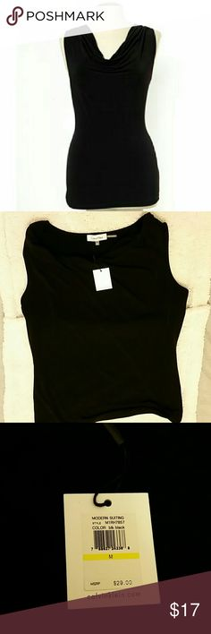Calvin Klein fluffy neck sleeveless blouse BNWT Black blouse is sleeveless with scruntchy neck. Perfect with a suit or to dress up a pair of jeans. Brand new with tags, never worn. Calvin Klein Tops Blouses