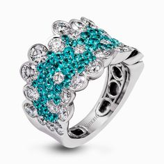 Presenting a dazzling contemporary design  this white gold ring is set with 2.96 ctw of stunning white diamonds and 1.43 ctw eye-catching Paraiba tourmaline stones.