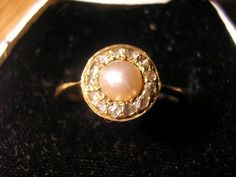 Pearl ring. Anyone that actually knows me would know I'd rather have a pearl over a diamond any day. Maybe it's less expensive but definitely just as classy.