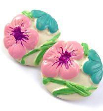 http://www.ebay.com/itm/Vintage-White-Celluloid-Plastic-Round-Flower-Painted-Enamel-Pierced-Earrings-/141600129448?pt=LH_DefaultDomain_0&hash=item20f80681a8