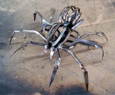 Christopher Locke Scissor Spider  Christopher Locke makes unique and creative sculptures out of scissors that were confiscated at airport security checkpoints.   Talented artist disassembles the scissors, bents them, and then welds them back together into cool metal sculptures that look like spiders.