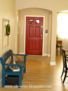 Paint front door on the inside - smart way to add color to a room. Could have an awesome outside color like red and a black door inside. Hmm