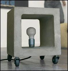 Concrete furniture as the cubic Nomade lamp