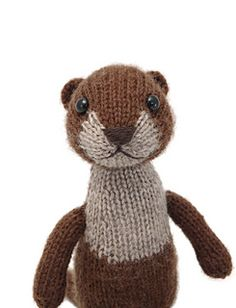A cute toy made with a range of fun knitting techniques, advanced-beginner to intermediate level. The pieces are all knit flat, then seamed and assembled. The tunic is knit in one piece from fingering weight yarn, with buttons to hold the ends of the straps.