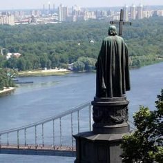 Dnipro river, Kiev, Ukraine. The Dnipro River cuts across ukraine and a statue of god in stone.