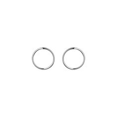 The Lines collection is built around the idea of an elegant simplicity, and the Small Circle earrings are very graphic, light and have a natural elegance to them. They are made of sterling silver.