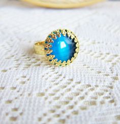 Lord of the Rings Blue Ring Gold Ring Sapphire Blue Exotic Persian Moroccan Spanish Style Gem Stone Cats Eye Glass Ring - Imogan II. $8.89, via Etsy.