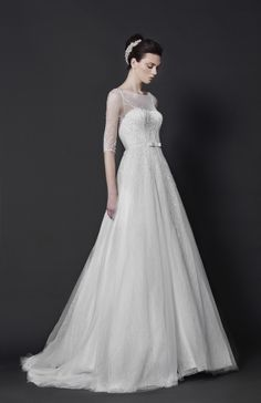 Off-White Lace ball gown with foliage crystal bead embroideries, three-quarter sleeves and a belted waist.