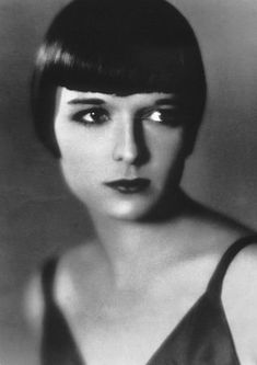 Actress Louise Brooks... a Ziegfeld Follies dancer who became a legendary actress of the silent film era in the 1920's. With her trademark bobbed hair style, she epitomized the flapper age while blatantly flaunting the accepted sexual and societal roles of women at the time.. Thousands of women were attracted to her bobbed hair style and adopted it as their own.
