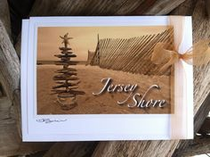 "This card set consists of six cards and envelopes featuring the ""Jersey Shore"" driftwood tree holiday card. Hand-created cards made with original photographs are hand-signed and blank inside. Card stock and envelopes are white. Cards measure 5"" x 6.5"". Card sets are packaged in a sealed, clear sleeve and adorned with a gold organza bow tie.  https://www.etsy.com/listing/165997099/jersey-shore-holiday-card-set-by-the?ref=related-2"