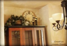 How to Decorate the Top of Cabinets from Creative Juices Decor