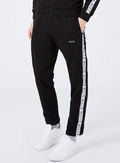 Pantalon de jogging noir avec bande et boutons-pression par Nicce - 50% off Brands & Accessories - Promos - TOPMAN FRANCE