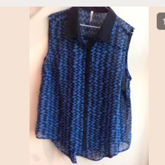 Hi  Lo blue Black Blue plus size top This is a brand new blouse there is no brand and no fabric content but it does have a size tag. the style is high - low short in the front and long in the back . Fabric is polyester . Blouse is sheer. Feel free to ask any questions. Tops