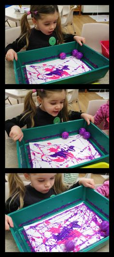 Globs of paint + Golf Balls + Tray = Rolling Painting Fun!
