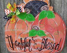 sunflower and pumpkin wood door hanger. Fall Wood Crafts, Fall Door, Wood Doors, Door Hangers, Pumpkins, Christmas Bulbs, Holiday Decor, Unique Jewelry, Handmade Gifts