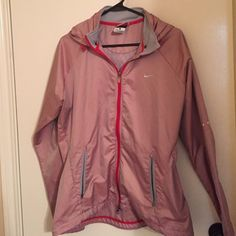 Nike Storm Fit Jacket OFFERS WELCOME! Great jacket for running and for rainy days as a rain jacket. The jacket is red with a reflective pattern. There is a detachable hood and many pockets. Nike Jackets & Coats