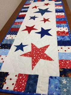 This Patriotic table runner or wall hanging is full of red, white and blue colors to decorate your home for your 4th of July celebration. The bright