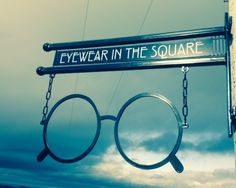 Opticians sign. Classic old town spectacles with a Rennie Mackintosh inspired bracket and text. On it's way to Scotland, where else.