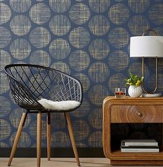 Connect the dots. Thin brushstrokes paint a full circle design with slight faded effect. Hand-printed exclusively by Hygge and West for CB2, gold and navy wallpaper adds graphic interest to the entry or as statement wall. Cross Hatch Circles Gold and Navy Traditional Paste Wallpaper is a CB2 exclusive.