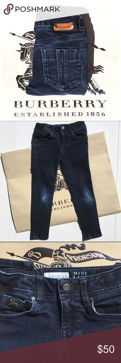 """Burberry Mini Langley skinny jeans - kids 5 Be sure your mini me is just as stylish as you are!  These darling Burberry """"Mini Langley"""" skinny leg jeans are the perfect addition to your child's wardrobe.   The indigo wash jeans feature the coveted leather Burberry patch on the back waistband and metal emblem on the front 5th pocket.    These jeans grow with your child as they feature an adjustable elastic tab inside the waistband. 98% cotton, 2% elastane   Previously loved, the knees show…"""