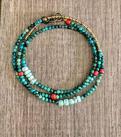 Boho Bracelet, Turquoise Bracelet, Beaded Wrap Bracelet, Dainty Beaded Bracelet, Gemstone Bracelet, Southwestern Jewelry, Bohemian Jewelry  Red rustic Indonesian glass beads make a few appearances among this strand of small turquoise beads and larimar beads. The bracelet measures 20.5 #beadedjewelry