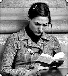 La Liseuse - Reading Woman. Paris. A common view in Paris — people read a lot. On terraces, cafés, in the metro, the bus, on the train.