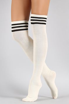 5b4a63f6a49f3 Shop Sparkling Triple Stripe Thigh High Socks featuring a solid knit  construction with three subtly-sparkling stripes at the top.