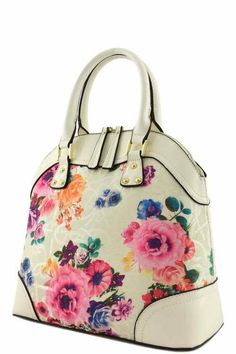 Adorable designer floral top handle bag available in 4 colors. Zipper top closure Textured faux leather Inside lining with open/zip pockets Rear zipper pocket 16 inch handles & 50 inch adjustable stra