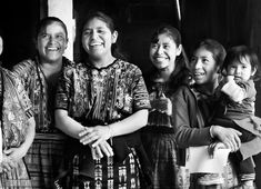 A smiling Guatemalan family. http://beersandbeans.com/2012/12/18/eat-weave-smile-a-guatemala-home-visit/