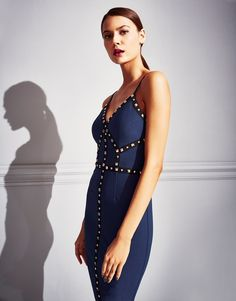Feel amazing in this bodycon dresses by Rare in navy. It features stud detail and cami straps, perfect for party. Complete the outfit with heels and clutch.