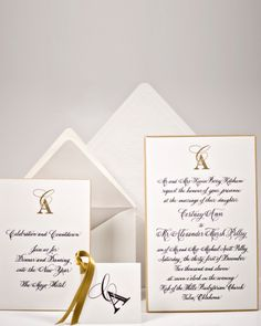 This engraved invitation suite features a gold border and custom monogram on double-thick paper stock.Bell'Invito
