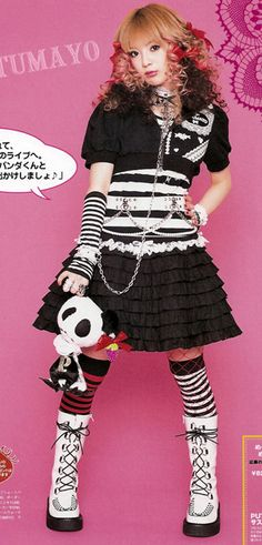Punk lolita draws inspiration from both punk and lolita fashion.  The fabrics are more disheveled and the colors stronger, like Gothic lolitas.  Accessories are very important in punk lolita.  Make up is a bit heavier than sweet or classic lolitas