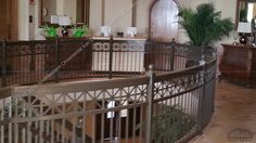 Upper guard rail surrounding the grand stair way.