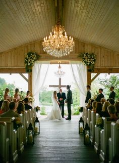 Christian Wedding Ideas:A cross instead of an arch. Photo by Kristin Sweeting