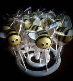 Bumble Bee cake pops - Eyes are fondant; mouth is edible marker; stripes are fondant; and wings are 3/4 of a candy melt wafer. (Hmmm, there must be a cleaner way to attach the wing?!)