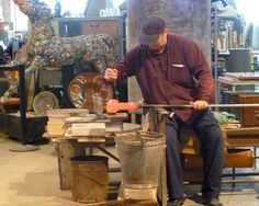 Murano, Italy, a boat ride away from Venice. Glass blowing factories. Here's an artisan at work.
