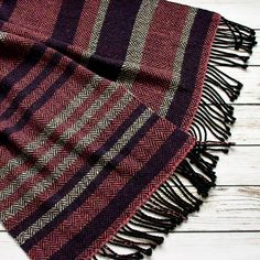 Handwoven scarf with purple, pink and white stripes. Merino scarf is soft to the touch, not itchy. The scarf was made on homemade wooden loom, so this item is one of a kind. Scarf suits well as an accessory for spring and autumn outfit. Measures approximately 17.7 x 71 plus fringe. Ready