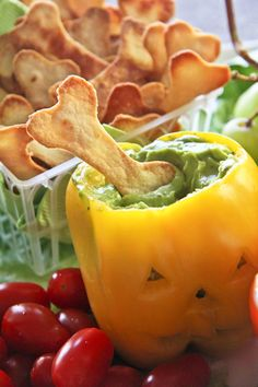 "Have a healthy Halloween!  Make ""slime"" filled pepper jack-o-lanterns and homemade bone shaped tortilla chips!"