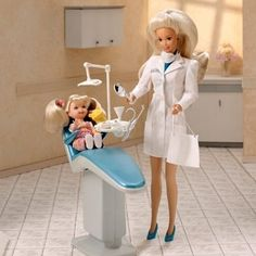 Dentist Barbie-I used to love to give all my barbie patients clean teeth!