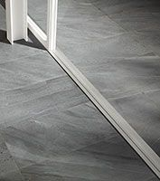 Co-ordinating indoor and outdoor slate effect large format porcelain tiles.