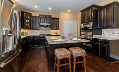 We love this kitchen (especially the large center island!) from our @lennarmaryland team!
